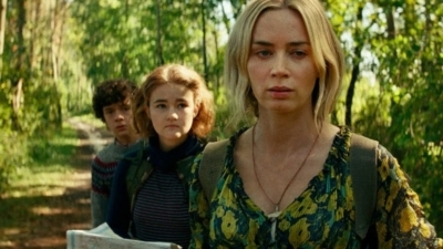 "A shot from ""Quiet Place. Part II"" with the main characters going through a forest."